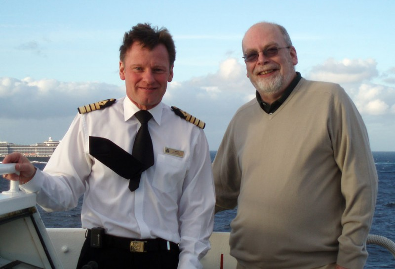 That's me on the bridge wing with QE2 's last master, Captain Ian McNaught