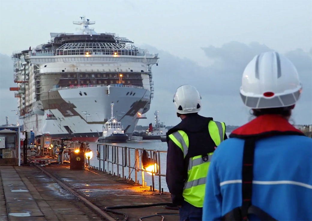 The world's largest cruise ship, Symphony of the Seas, is floated out of dry dock